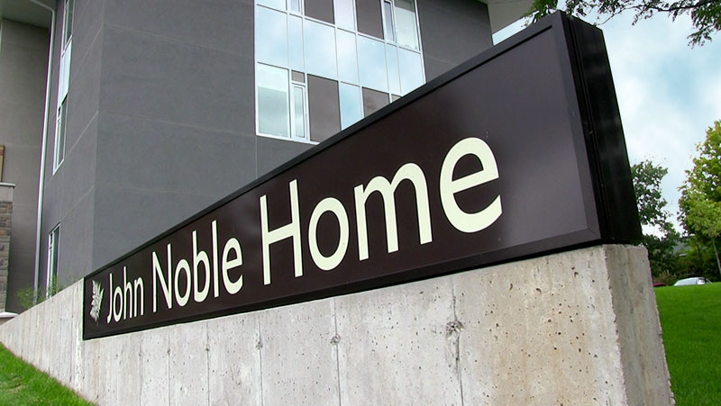 The John Noble Home driveway sign.